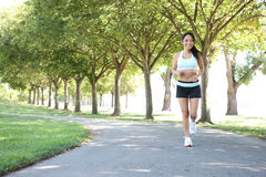 Pretty Woman Jogging in Park Royalty Free Stock Photography
