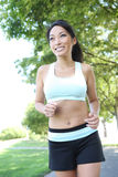 Pretty Woman Jogging in Park Royalty Free Stock Image