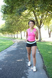 Pretty Woman Jogging in Park Stock Photography
