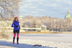 Pretty Woman Jogging in winter with earphones Stock Photography