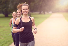 Pretty Woman Jogs in the Park with Other Girls Stock Images
