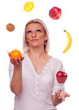 Woman juggling with fruits Royalty Free Stock Photography