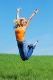PRETTY WOMAN JUMP-2. PRETTY WOMAN JUMP ON THE MEADOW Stock Photo