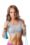 Pretty woman with a jump rope Stock Images
