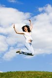 Pretty woman is jumping Stock Photo