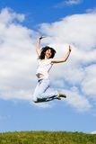 Pretty woman is jumping Royalty Free Stock Image