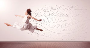 Pretty woman jumping with hand drawn lines and arrows come out Royalty Free Stock Photos