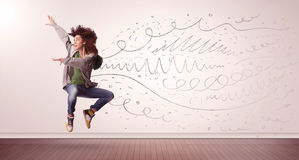 Pretty woman jumping with hand drawn lines and arrows come out Royalty Free Stock Image