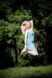 Pretty Woman Jumping High Stock Image