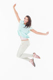Pretty woman jumping looking at camera Stock Image