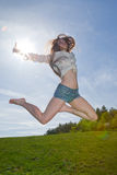 Pretty woman jumping Stock Image