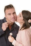 Pretty woman kissing. Pretty women kissing a men which is listening to his heartbeats Stock Images