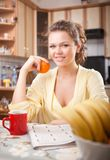 Pretty woman in the kitchen Royalty Free Stock Images