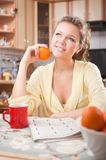 Pretty woman with in the kitchen Stock Photography