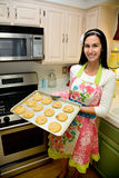 Pretty Woman in Kitchen Baking Cookies Stock Images