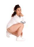 Pretty woman kneeling on floor. Stock Image