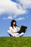 Pretty woman with laptop Stock Photography