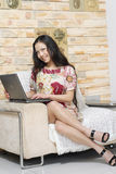 Pretty woman with laptop Royalty Free Stock Photo