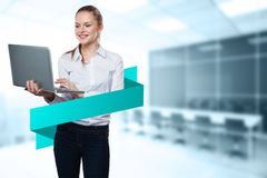 Pretty woman with laptop and banner Royalty Free Stock Image