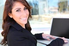 Pretty Woman on Laptop Computer Stock Photo
