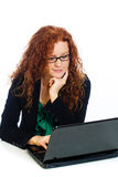 Pretty woman on laptop computer Stock Photography