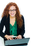 Pretty woman on laptop computer Royalty Free Stock Image