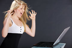 Pretty woman with laptop and flying hair Royalty Free Stock Photos