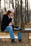 Pretty woman with laptop outdoors Royalty Free Stock Photography