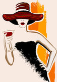 Pretty woman with large hat having cocktail Stock Photography