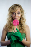 Pretty woman with large lollipop Royalty Free Stock Photo