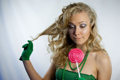 Pretty woman with large lollipop Royalty Free Stock Images