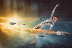 Pretty woman in latex costume dodging bullet Royalty Free Stock Photos