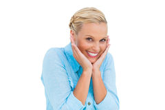 Pretty woman laughing at camera with hands on face Royalty Free Stock Photo