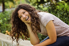 Pretty Woman Laughing Casually in Park Setting Royalty Free Stock Photos