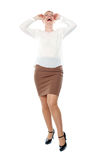 Pretty woman laughing loud. Full length shot. All on white background royalty free stock images
