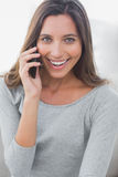Pretty woman laughing while she is on the phone Royalty Free Stock Images