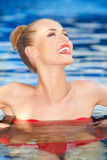 Pretty woman laughing while swimming Stock Photos