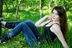 Pretty woman lay in green grass Royalty Free Stock Photos