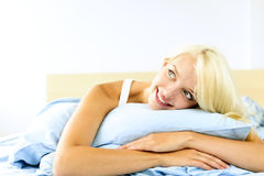 Pretty woman laying in bed daydreaming Royalty Free Stock Photo