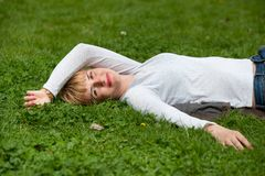 Pretty woman laying on the grass Stock Images