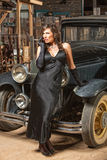 Pretty Woman Leaning on Car Stock Image