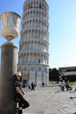 Pretty Woman at Leaning Tower of Pisa Stock Images