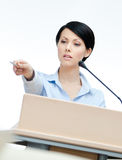 Pretty woman lecturer at the podium stock photos