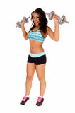 Pretty woman lifting dumbbell's. Royalty Free Stock Images