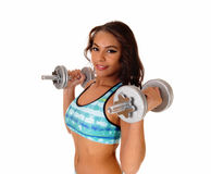 Pretty woman lifting dumbbell's. Stock Photography