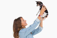 Pretty woman lifting her chihuahua up Stock Image