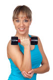 Pretty woman lifting weights Royalty Free Stock Images