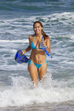 Pretty woman in light blue bikini going snorkeling Royalty Free Stock Photo