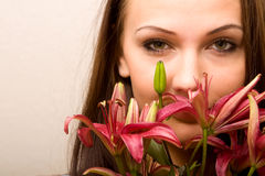 Pretty woman with lily Royalty Free Stock Photo