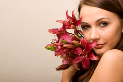 Pretty woman with lily Stock Photo